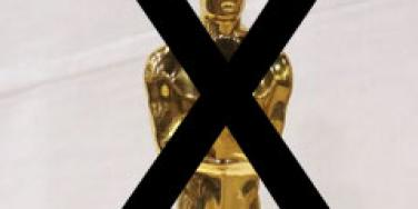 oscar statue with an x on it