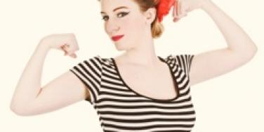 feminine woman flexing her arms red lips