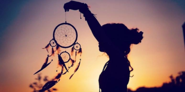 girl holding dreamcatcher