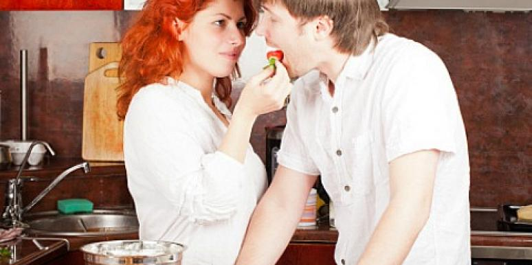 couple enjoying stawberries