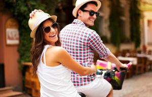 couple riding bikes.
