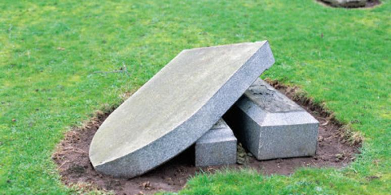 knocked down tombstone