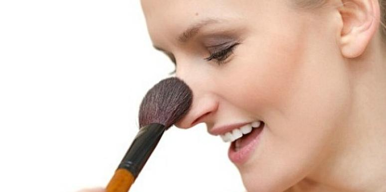 woman applying blush