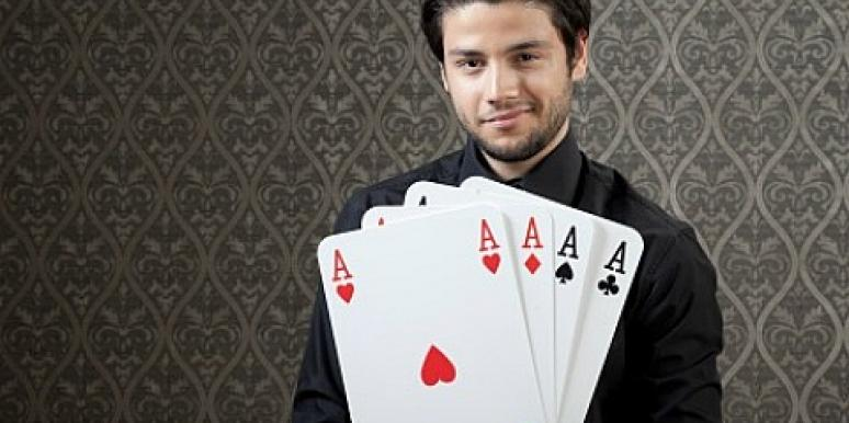 guy holding cards