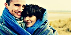 couple wrapped up in blanket