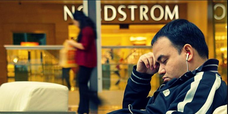 man sleeping at mall
