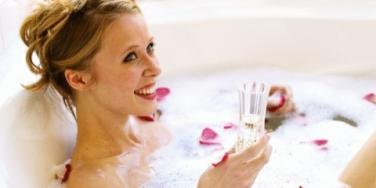 woman with bubble bath and champagne