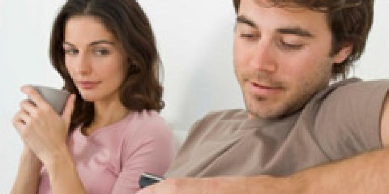 man texting on phone ignoring woman