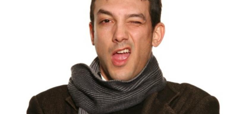 man winking with scarf