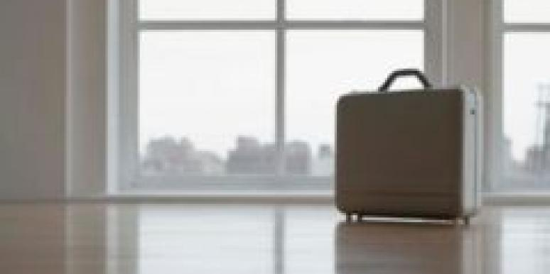 suitcase in an empty room