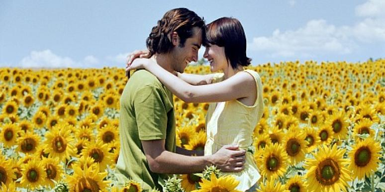 couple in sunflower field.