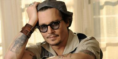 Johnny Depp wearing glasses