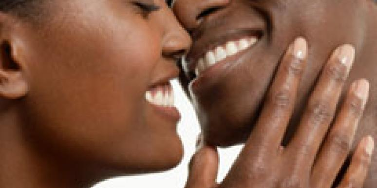 close up of couple smiling about to kiss