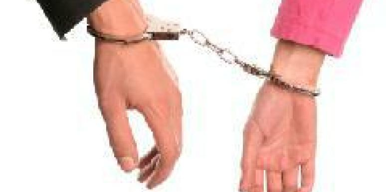 couple handcuffed to each other
