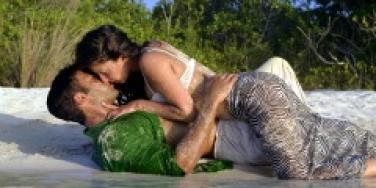 Couple kissing making out on the beach