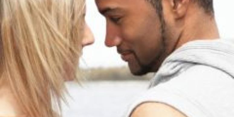 caucasian female black male interracial couple intimate look