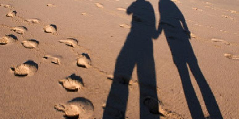 shadow of tall couple on sand