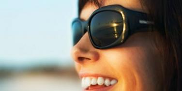 smiling woman wearing shades