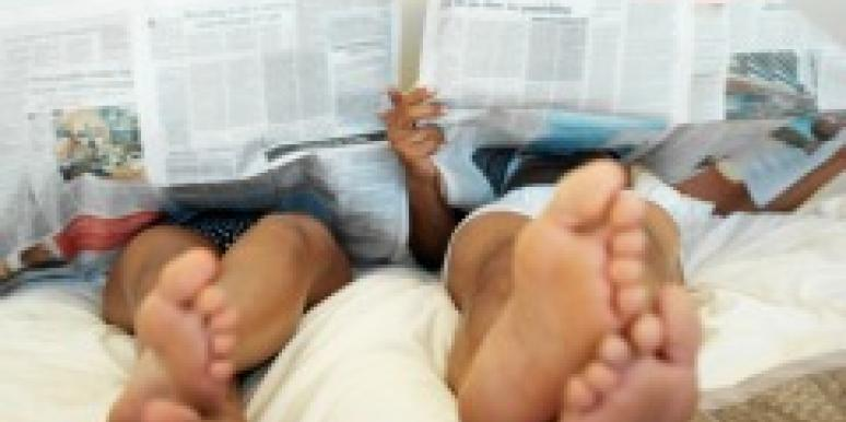 newspapers in bed