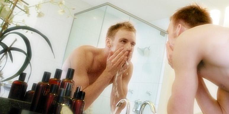 man putting on cologne
