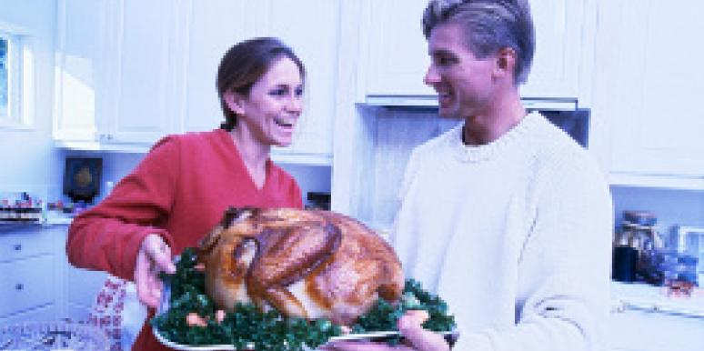 couple cooking the thanksgiving turkey