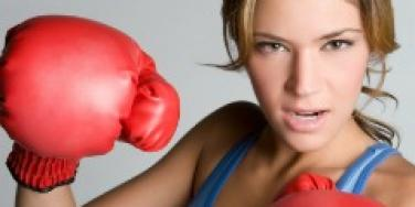 female fighter with boxing gloves