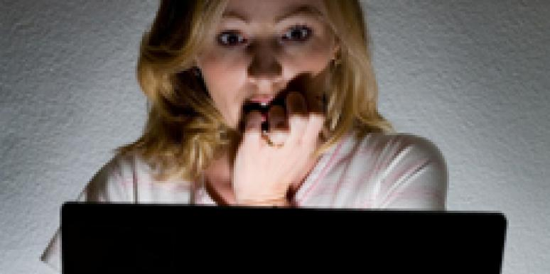 scared woman looking at computer