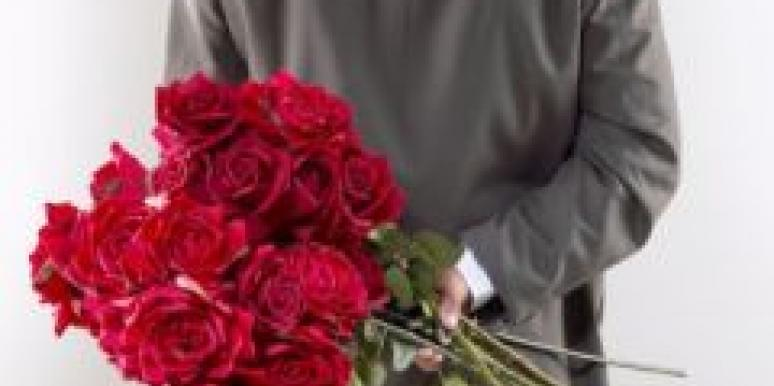man and red roses