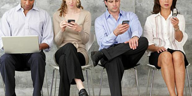 group of people using cellphones