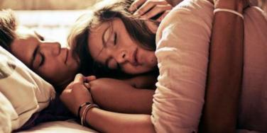Girl sleeping on his chest