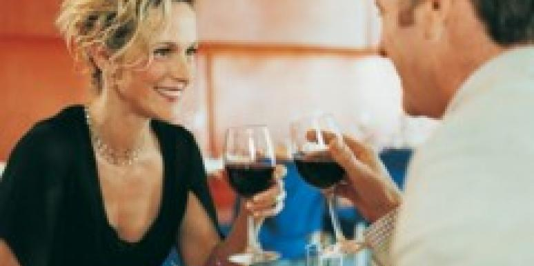 couple at dinner sipping wine