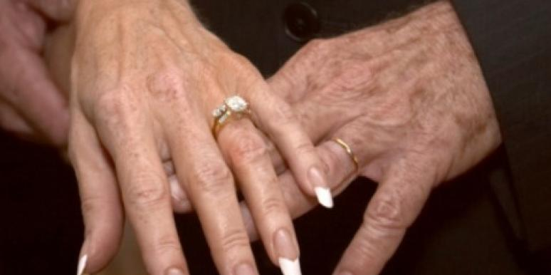 older hands with wedding ring