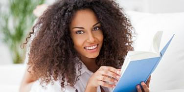 happy woman reading book
