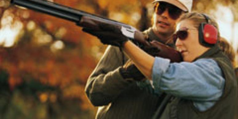 couple shooting a shotgun during hunting season