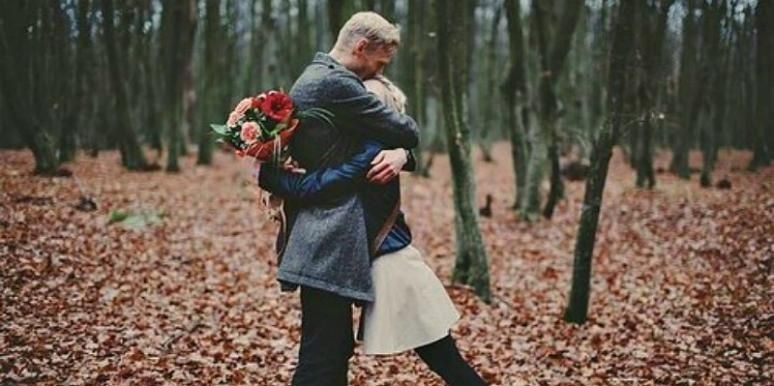 Couple in the Woods Hugging