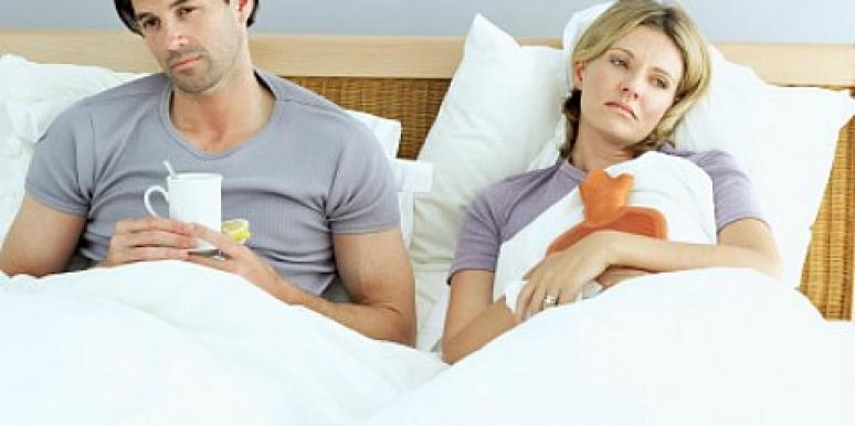 sad bored couple in bed with cold
