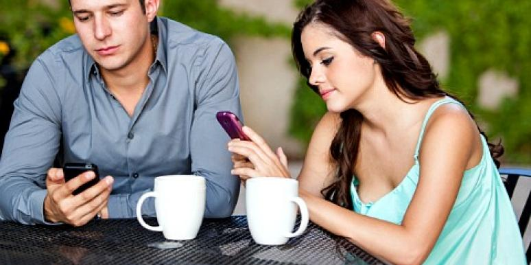 woman on phone during date