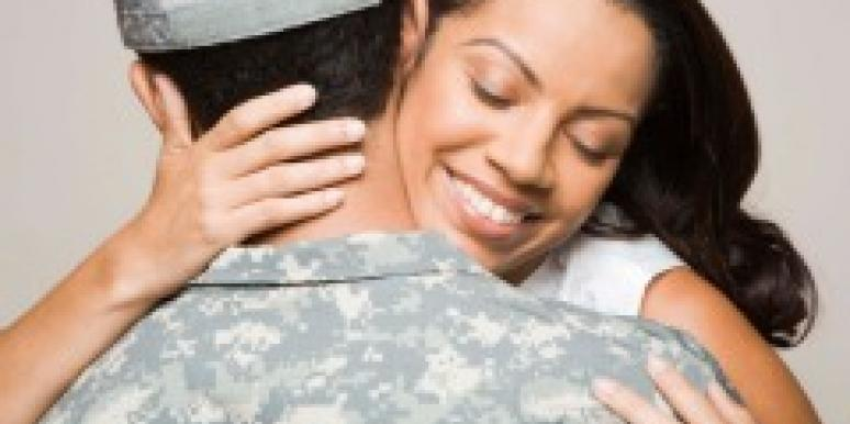 military couple embracing