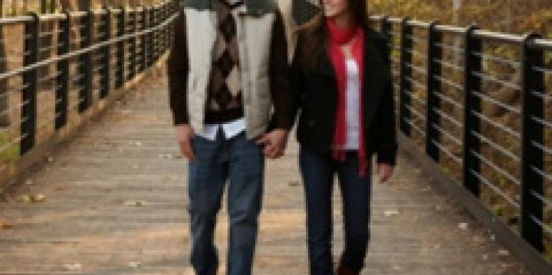 Man and woman walking on a bridge