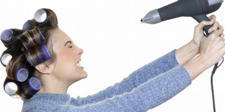 woman using hairdryer