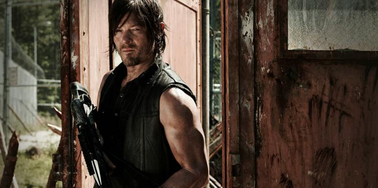 Norman Reedus as Daryl Dixon holding a crossbow and wearing his signature leather vest in AMC 'The Walking Dead' Season 5