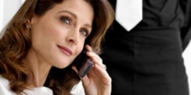 Brunette woman holding a phone