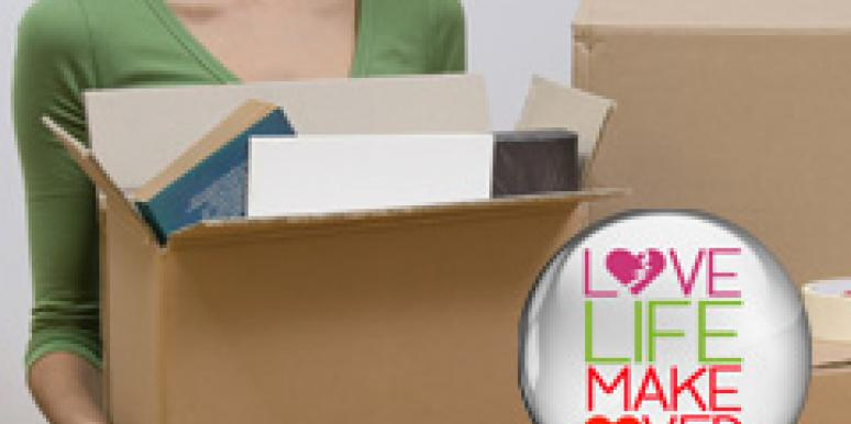 woman moving out boxes after breakup