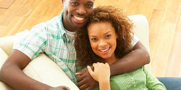 happy young couple on a sofa