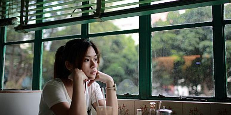 sad woman in diner