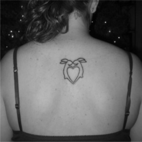 Animal testing bunny heart tattoo