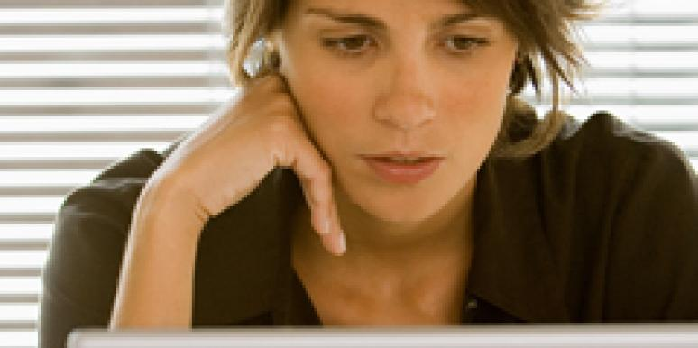 woman looking at computer