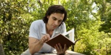Man reading on a picnic table