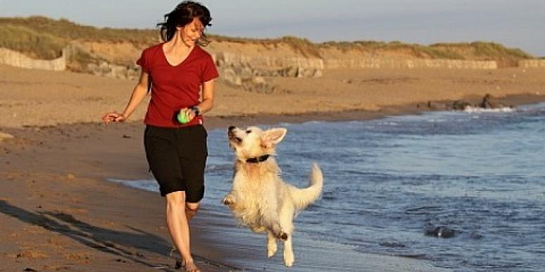 woman running with a dog