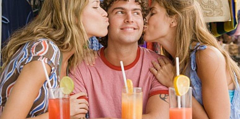 two girls kissing one guy on the cheek